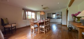 Spacious kitchen / dining room with oak flooring & patio doors to garden